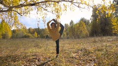 Slow Motion Girl Acrobatics Background Leaf Fall. Sunny Day. Stock Footage
