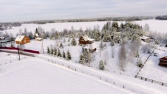 Flight above countryside with timber houses and barns at winter season. Russia Stock Footage
