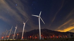 Astro Timelapse of Array of Windmills in Palm Springs -Zoom In- Stock Footage