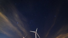 Astro Timelapse of Array of Windmills in Palm Springs -Tilt Up- Stock Footage