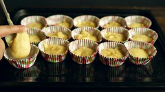 Chef put dough into baking tray. Muffin cake preparation. Cooking muffins Stock Footage