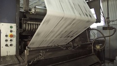 Long uncut paper on rolling machine in printing house Stock Footage