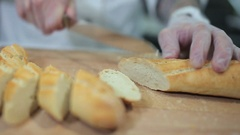 Chef serving crusty baguette Stock Footage