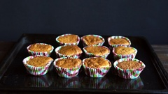 Chef take away cupcake from baking tray. Cooked cupcakes on baking pan Stock Footage
