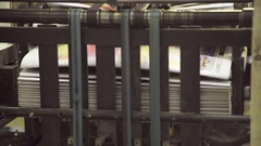 Bundle of newspapers in machine stored paper lot in printing house Stock Footage