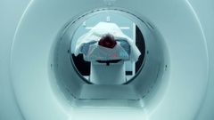 Man Getting Scan Done In Hospital With HUD Display Technology in Machine Stock Footage