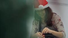 Elf is repairing wonderful toy to hang it on Christmas tree Stock Footage