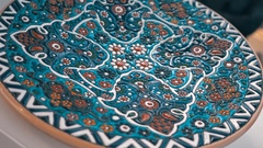 Beautiful national dish with oriental embossed ornaments in the bazaar Stock Footage