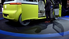 Tilt up on autonomous VW self-driving van on display at Detroit Auto Show Stock Footage