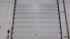 High white metal gates shutters of the hangar Stock Footage
