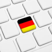 German language or Germany web concept. National flag button or key on keyboa Stock Photos