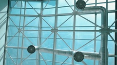 High glass ceiling of the building with ventilation pipes Stock Footage