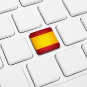 Spanish language or Spain web concept. National flag button or key on keyboar Stock Photos