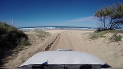 4x4 vehicle driving down to 75 mile beach on Fraser Island Stock Footage