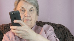 Aged woman 80s taking selfie using mobile phone Stock Footage