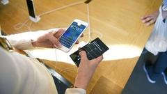 Fast new iPhone vs slow Windowsphone Stock Footage