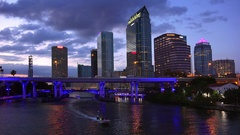 Tampa, Florida City Skyline Along Downtown Waterfront at Night - Logos Blurred Stock Footage