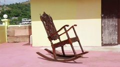 Old dirty terrace whith rocking chair Stock Footage