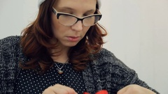 Pretty woman ties red ribbon into beautiful bow Stock Footage