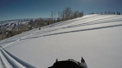 Winter recreation snowmobile across mountain slope POV 4K Stock Footage
