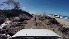 4x4 vehicle driving over rocks on Fraser Island Stock Footage