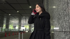 Winter Season Cold Weather With Asian Businesswoman On The Phone Stock Footage