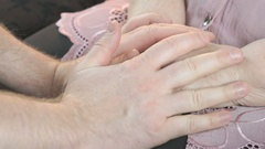 Man strokes old wrinkled woman's hands. Close up Stock Footage
