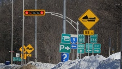 Road signs and traffic light. Winter in Wakefield, Quebec, Canada. Stock Footage