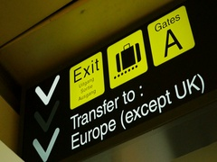 Exit sign and other airport sign in modern terminal pov Stock Footage