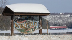 Sign for the village of Wakefield in Quebec, Canada. Winter. Stock Footage