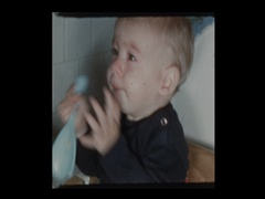 Baby boy claps on old fashioned antique potty Stock Footage