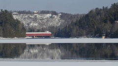 Gatineau river and famous red covered bridge. Wakefield, Quebec. Stock Footage