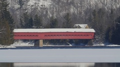 Famous red covered bridge and Gatineau river. Wakefield, Quebec. Stock Footage