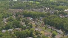 AERIAL: Luxury suburban houses in quiet modern neighborhood on sunny summer day Stock Footage