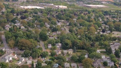 AERIAL: Traffic on busy highway near luxury suburban town with perfect houses Stock Footage