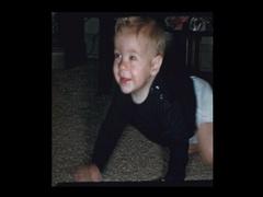 Happy baby boy crawls furiously Stock Footage