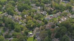 AERIAL: Luxury suburban houses in quiet modern neighborhood on sunny autumn day Stock Footage