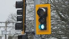 Traffic light with green signal. Snowstorm. Winter in Richmond, BC. Stock Footage
