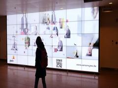 PWC PriceWaterHouse Coopers Audit career advertising in airport Stock Footage