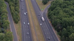 AERIAL: Semi trucks and personal cars speeding on interstate in the morning Stock Footage