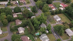 AERIAL: Quiet luxury suburban town with spacious exquisite houses in lush nature Stock Footage