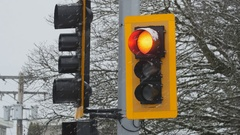 Traffic light with red signal. Snowstorm. Winter in Richmond, BC. Stock Footage