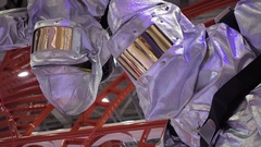 Metal suit against heat and fire. Work clothes fireman, rescuer and steelworker Stock Footage