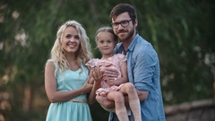 Family posing for picture Stock Footage