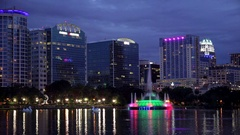 Orlando, Florida City Skyline and Water Fountain at Night - Logos Blurred Arkistovideo
