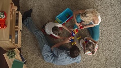 Family playing with construction toys Stock Footage