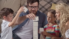 Family stacking toy blocks Stock Footage