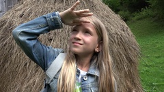 4K Child Looking up in Sky, Tourist Girl Portrait Watching, Haystack in Mountain Arkistovideo
