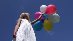 4K Child Playing with Balloons Looking at Blue Sky, Happy Girl Birthday Outdoor Arkistovideo