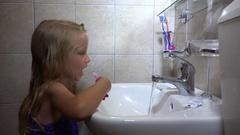 4K Child Brushing Teeth, Girl Portrait Washing Using Toothbrush in Bathroom Stock Footage